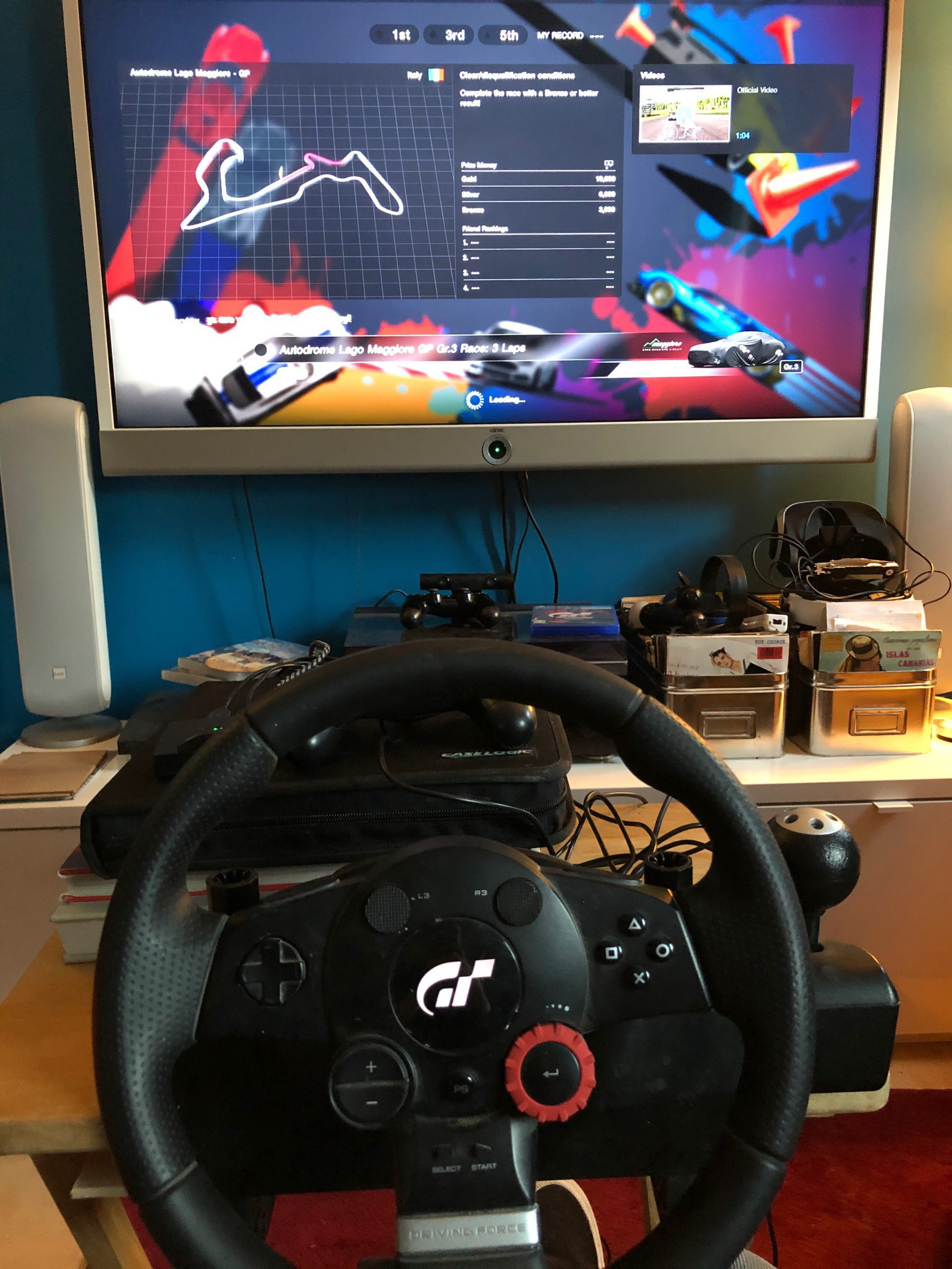 image of GT sport steering wheel with GT Sport game on PS4